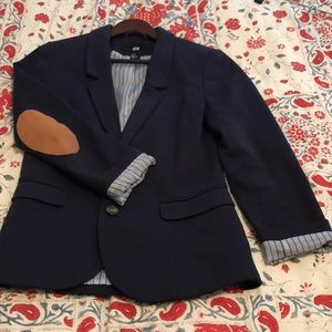Casual navy jacket with tan suede elbow patches